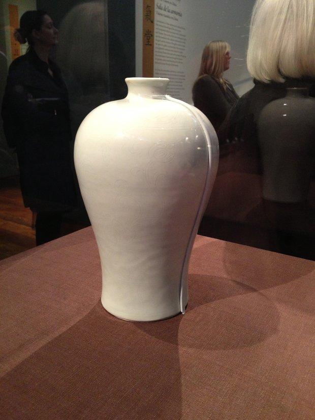 Mechanical mount, sloping alongside this vase