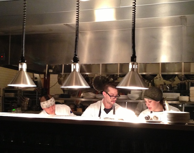 Cooks in the kitchen at Restaurant Zoe.